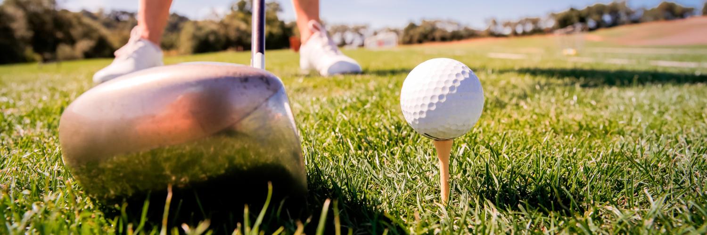 golf club and golf ball teed up