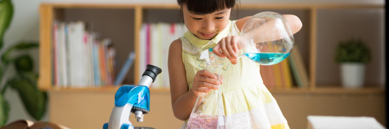 Little girl doing science experiment